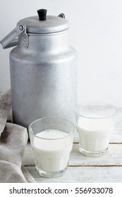 cans and glasses of milk