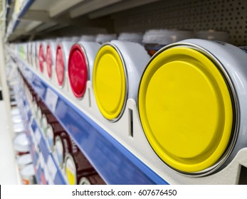 Cans with paint on shelf, color bucket on shelf in color store
