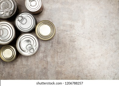 Cans of preserves on a marble table
