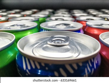 A lot of cans in supermarket shelf