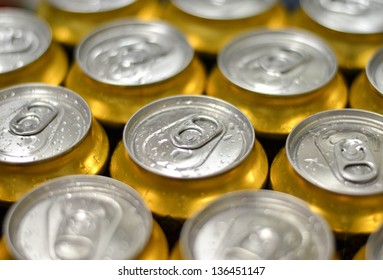 Cans with water drops macro shot