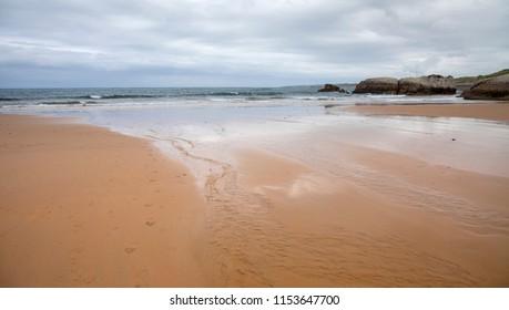 Cantabria, coastal landscape around Isla Virgen de Mar, overcast day
