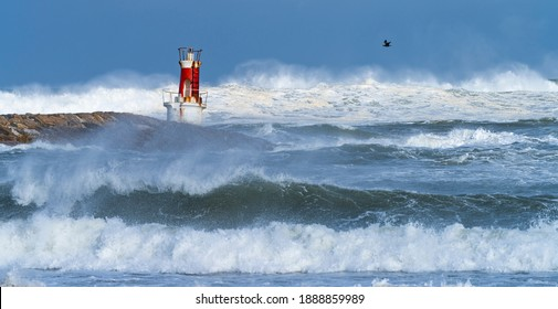 Cantabrian Sea swell in the buoy of La Barra lighthouse of San Vicente de la Barquera village located at the mouth of the harbour within Oyambre Natural Park in Cantabria, Spain, Europe