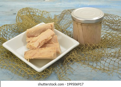 Cantabrian Sea Tuna, albacore in olive oil wooden background