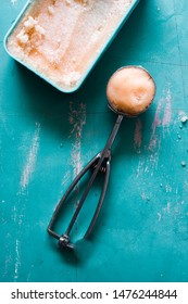 Cantaloupe granita on a blue background, natural light, top view flatlay