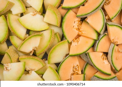 Cantaloupe and honeydew melon slices. Full frame close up food background.