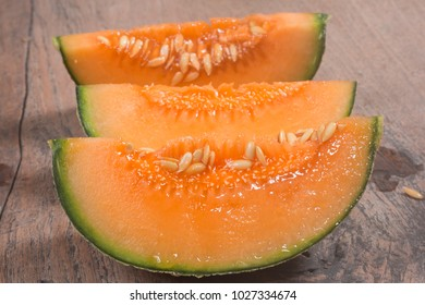 cantaloupe melon isolated on wood background