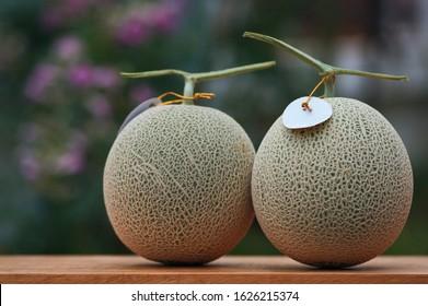 The cantaloupe melon on a wicker basket