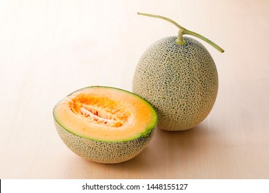 Cantaloupe melon on wooden background