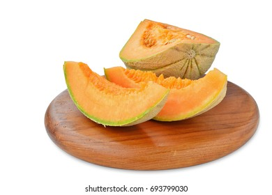 Cantaloupe melon on wooden board isolated on white background