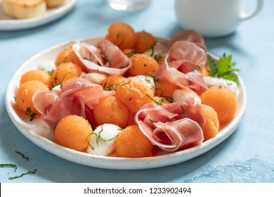 Cantaloupe melon salad with mozzarella and prosciutto ham