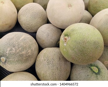 Cantaloupe melons sell in the market. Cantaloupe melons in market. Cantaloupe melons background.