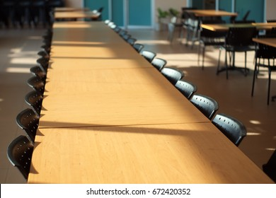 Canteen with chairs and tables. Dining table.