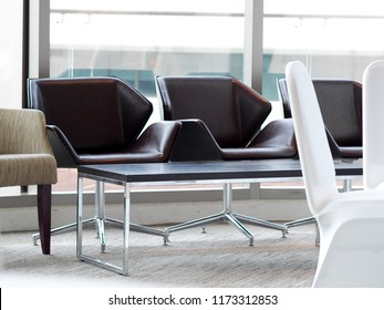 canteen lounge seat chair in modern minimal loft style house crop closeup with large glass window background for semi casual business environment style backdrop background use