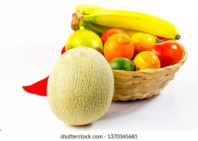 Canteloupe in Front of Fruit Basket on White BG with Copy Space