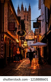 Canterbury, England - April 15 2018: Butchery Lane in historic Canterbury seen at blue hour with a person passing by.