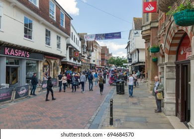CANTERBURY, ENGLAND - JUNE 07, 2017: Shopping street with people downtown old historic Canterbury city, Kent, England