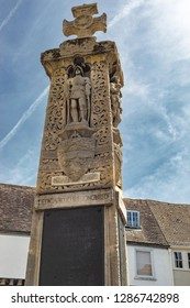 Canterbury, England - June 24, 2018: View the iconic Canterbury War Memorial sculpture in the middle of a street surrounded by houses in Kent, United Kingdom.
