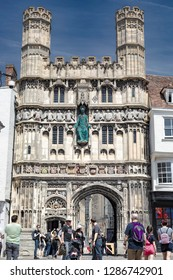 Canterbury, England - June 24, 2018: View of tourists in front of the front gate tower entrance of the cathedral of Canterbury in Kent, United Kingdom.