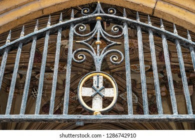 Canterbury, England - June 24, 2018: Close up view of the entrance gate and coats of arms of the cathedral of Canterbury in Kent, United Kingdom.