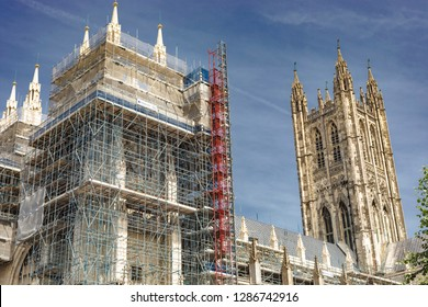 Canterbury, England - June 24, 2018: Construction scaffoldings around the iconic landmark of the Canterbury Cathedral for its renovation in Kent, United Kingdom.