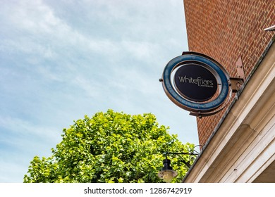 Canterbury, England - June 24, 2018: Street sign of Whitefriars Canterbury indicating the area of the biggest shopping centre in East Kent.