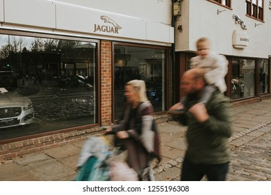 CANTERBURY, ENGLAND - October 28th, 2018: Jaguar car dealership facade in Canterbury city, with people walking by the sidewalk, in Kent, England.