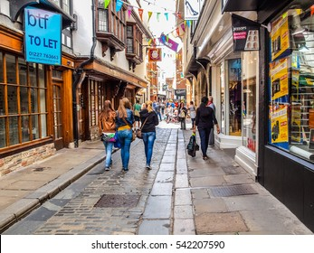 CANTERBURY, ENGLAND, UK - SEPTEMBER 11: Tourists visiting the city centre on September 11, 2012 in Canterbury, England, UK (HDR)