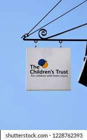 CANTERBURY - JUNE 30, 2018. A projecting sign over The Children's Trust charity shop on St Peter's Street at Canterbury, Kent, England, UK.