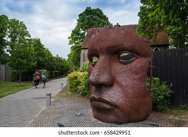 Canterbury, Kent, England - May 15 2017:  The face Mask or Bulkhead art created by Rick Kirby , British sculptor sitting outside Marlowe Theatre at the city of Canterbury, Kent UK.