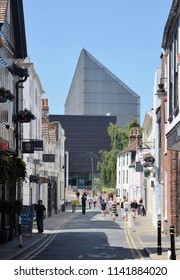 CANTERBURY, KENT, UK - JUNE 30, 2018. An ancient narrow city street dominated by the Marlowe Theatre fly tower designed by Keith Williams, and opened in 2011, at Canterbury, Kent, England, UK.