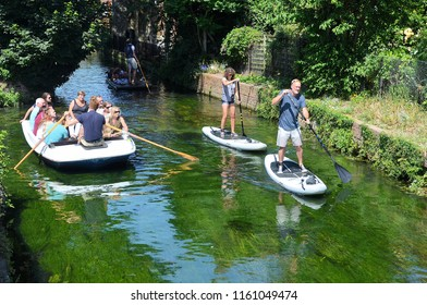 CANTERBURY, KENT, UK - JUNE 30, 2018. Rowing and punting on the the Stour River at Canterbury in the English county of Kent, UK.