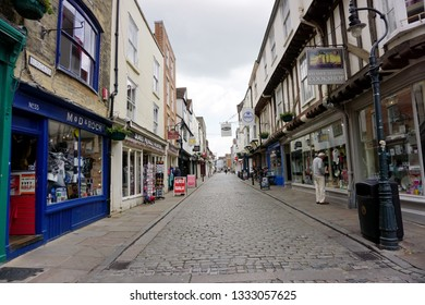 CANTERBURY, KENT, UK-21 JUNE 2015: Shopping street with unidentified people of the old town of Canterbury, Kent, England. Canterbury is a historic English cathedral city