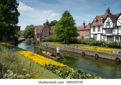 Canterbury, Kent, United Kingdom - 7 July 2017:Tourist  people taking a romantic boat ride in the canal of the river stour at the beautiful Chartham gardens in the city of  Canterbury, United Kingdom.