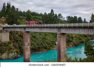 Canterbury, New Zealand, April 2019: A traction engine towing cabins travels over the Waimakariri Gorge Bridge on its way to the Steam Extravaganza