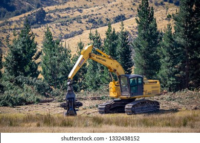 Canterbury, New Zealand, March 3 2019: Logging machinery working at a forestry site in the Canterbury foothills