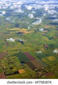 Canterbury Plains aerial view as the mist clears on an Autumn morning, New Zealand. In the background are the Southern Alps.