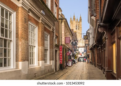 Canterbury, UK - Jan 29 2018. A view of Canterbury Cathedral at the bottom of the cobbled Butchery Lane.  The cathedral is the Anglican mother church and seat of the Archbishop of Canterbury
