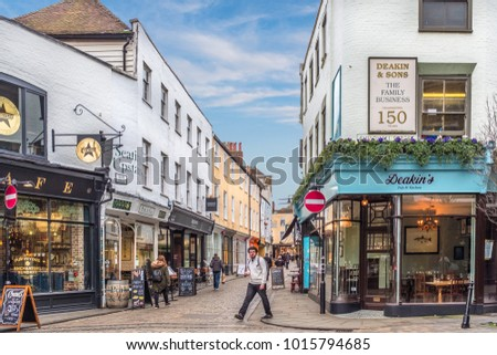 Canterbury, UK - Jan 29 2018. The cobbled paving of Sun St in the historic city of Canturbury. The street is pedestrianised and popular with tourists and locals for shopping, cafes and restaurants.