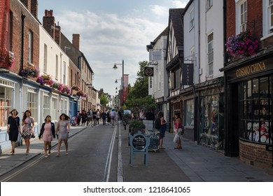 Canterbury, UK - July 19, 2018: Shopping street and people walking in the center of the medieval city Canterbury in Kent, UK