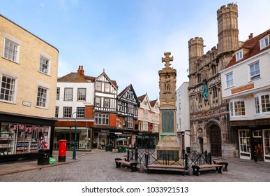 CANTERBURY, UK - JUN 1, 2013: The War Memorial and Cathedral entrance at Buttermarket square in the morning. Canterbury is a historic English cathedral city and UNESCO World Heritage Site