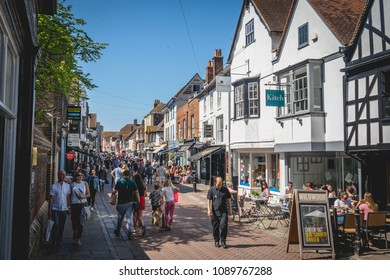 Canterbury, UK - May, 2018. Tourists on the medieval street of the historic town in Kent, South-East England. Canterbury is one of the most-visited cities in the United Kingdom.