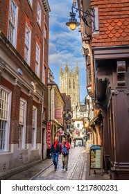 Canterbury, UK - Oct 31 2018. A view of Canterbury Cathedral at the bottom of the cobbled Butchery Lane.  The cathedral is the Anglian mother churchand seat of the Archbishop of Canterbury