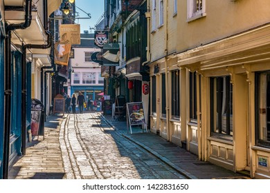 CANTERBURY, UNITED KINGDOM - FEBRUARY 23: This is a cobblestone street with traditional British architecture and shops on February 23, 2019 in Canterbury