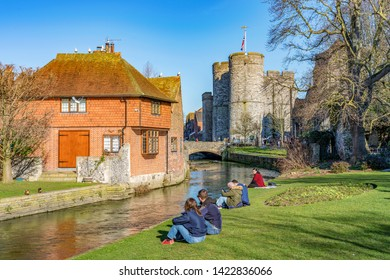 CANTERBURY, UNITED KINGDOM - FEBRUARY 23: View of people sitting at the riverside area along the River Stour canal on a sunny day on February 23, 2019 in Canterbury