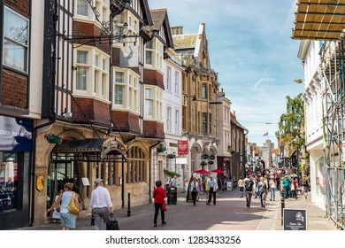 Canterbury, United Kingdom - June 24, 2018: People strolling down the streets of Canterbury on a sunny day in England.
