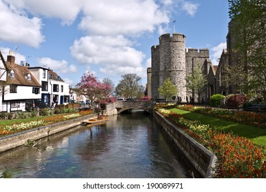 CANTERBURY,UK-APRIL 17: The  Westgate Towers and gardens. The towers are the largest surviving medieval gate in England. Canterbury has over six million visitors a year.April 17 2014, Canterbury UK