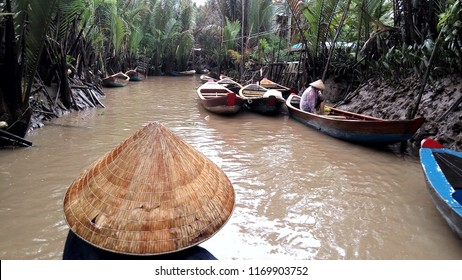 CANTHO, Vietnam July 18, 2018: Men rowing in a Vietnamese boat rides a boat on the Mekong River in Vietnam. A serene river tour on Mekong Delta, Can Tho Vietnam.