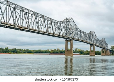 cantilever Cairo Ohio River Bridge in fall scenery with river barges in backgroiund, it provides river crossing between Wickliffe, Kentucky and Cairo, Illinois