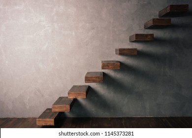 Cantilevered dark wooden staircase . Minimalism style,ascending diagonal